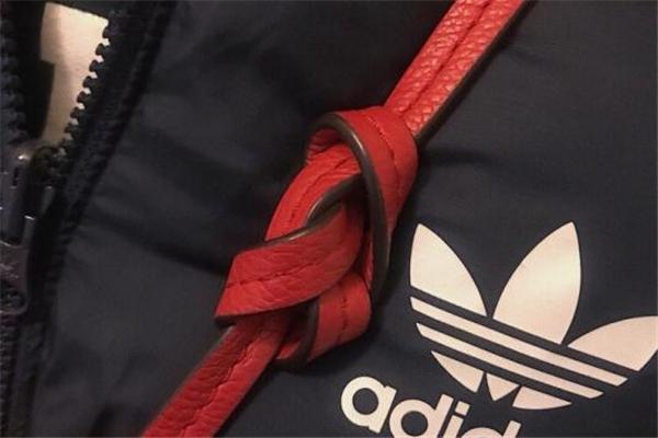 斜挎包带子太长如何打结 方法非常简单